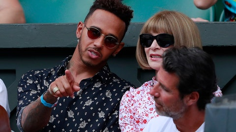 Lewis Hamilton and Anna Wintour sit in the player's box of Serena Williams during the women's singles final match between Serena Williams of the US and Angelique Kerber of Germany at the Wimbledon Tennis Championships, in London, Saturday July 14, 2018. (Andrew Couldridge, Pool via AP)
