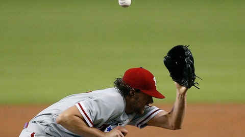 Philadelphia Phillies starting pitcher Aaron Nola ducks under a line drive by Miami Marlins' Derek Dietrich during the first inning of a baseball game Saturday, July 14, 2018, in Miami. (AP Photo/Brynn Anderson)