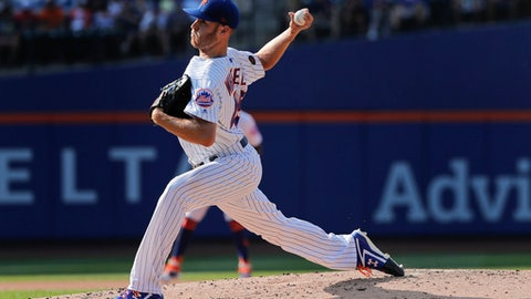 New York Mets starting pitcher Zack Wheeler delivers against the Washington Nationals during the fourth inning of a baseball game, Saturday, July 14, 2018, in New York. (AP Photo/Julie Jacobson)