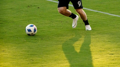 D.C. United forward Wayne Rooney warms up before an MLS soccer match against the Vancouver Whitecaps at Audi Field, Saturday, July 14, 2018, in Washington. (AP Photo/Alex Brandon)