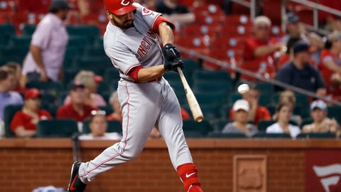 Cincinnati Reds' Eugenio Suarez hits a two-run single during the seventh inning of the team's baseball game against the St. Louis Cardinals on Saturday, July 14, 2018, in St. Louis. (AP Photo/Jeff Roberson)