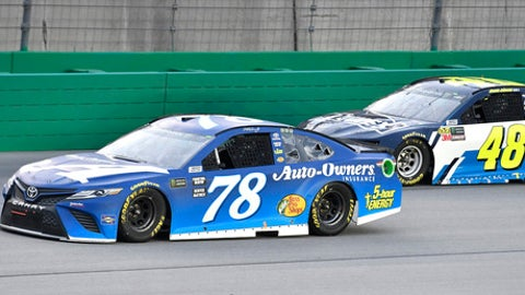 Martin Truex Jr. (78) tries to hold off a pass attempt by Jimmie Johnson (48) during the NASCAR Cup Series auto race at Kentucky Speedway, Saturday, July 14, 2018, in Sparta, Ky. (AP Photo/Timothy D. Easley)