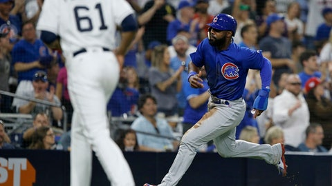Chicago Cubs' Jason Heyward, right, sprints by San Diego Padres starting pitcher Luis Perdomo to score on a two-run double by Javier Baez during the fifth inning of a baseball game in San Diego, Saturday, July 14, 2018. (AP Photo/Alex Gallardo)