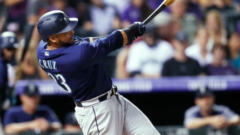 Seattle Mariners pinch-hitter Nelson Cruz follows through on a single off Colorado Rockies starting pitcher Jon Gray during the eighth inning of a interleague baseball game Saturday, July 14, 2018, in Denver. Colorado won 4-1. (AP Photo/David Zalubowski)