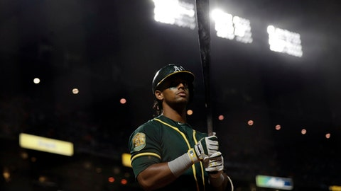 Oakland Athletics' Khris Davis waits on deck during the seventh inning of the team's baseball game against the San Francisco Giants on Saturday, July 14, 2018, in San Francisco. (AP Photo/Marcio Jose Sanchez)