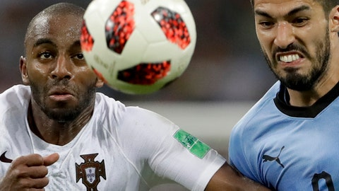 FILE - In this Saturday, June 30, 2018 file photo Uruguay's Luis Suarez, right, challenges for the ball with Portugal's Ricardo during the round of 16 match between Uruguay and Portugal at the 2018 soccer World Cup at the Fisht Stadium in Sochi, Russia. (AP Photo/Andre Penner, File)