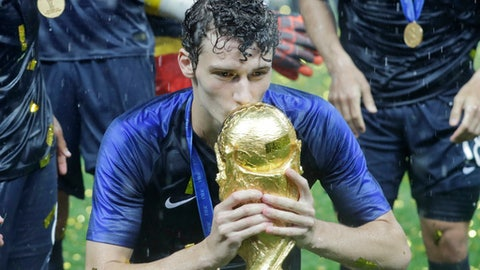 France's Benjamin Pavard kisses the trophy at the end during the final match between France and Croatia at the 2018 soccer World Cup in the Luzhniki Stadium in Moscow, Russia, Sunday, July 15, 2018. (AP Photo/Matthias Schrader)