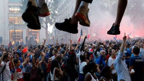 People march on the Champs Elysees avenue after France won the World Cup final between France and Croatia, Sunday, July 15, 2018 in Paris. France won its second World Cup title by beating Croatia 4-2. (AP Photo/Laurent Cipriani)