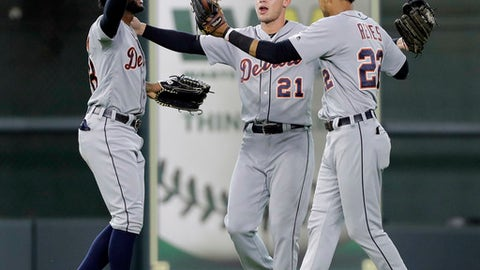 Detroit Tigers' JaCoby Jones (21), Victor Reyes (22) and Niko Goodrum celebrate after a baseball game against the Houston Astros, Sunday, July 15, 2018, in Houston. (AP Photo/David J. Phillip)