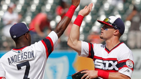 Chicago White Sox's Tim Anderson, left, and Adam Engel celebrate their team's win over the Kansas City Royals in a baseball game Sunday, July 15, 2018, in Chicago. (AP Photo/Jim Young)