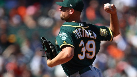 Oakland Athletics pitcher Blake Treinen works against the San Francisco Giants in the ninth inning of a baseball game Sunday, July 15, 2018, in San Francisco. (AP Photo/Ben Margot)