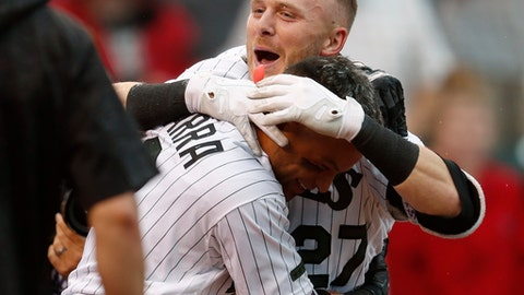 Colorado Rockies' Gerardo Parra, front, hugs Trevor Story (27) who crosses home plate after hitting a solo walkoff home run off Seattle Mariners relief pitcher Nick Vincent in the ninth inning of an interleague baseball game Sunday, July 15, 2018, in Denver. (AP Photo/David Zalubowski)