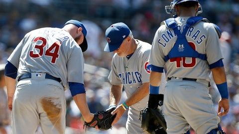 Chicago Cubs manager Joe Maddon, center, takes the ball out of the glove of starting pitcher Jon Lester, left, and pulls him out of a baseball game with catcher Willson Contreras watching during the sixth inning of a baseball game in San Diego, Sunday, July 15, 2018. (AP Photo/Alex Gallardo)