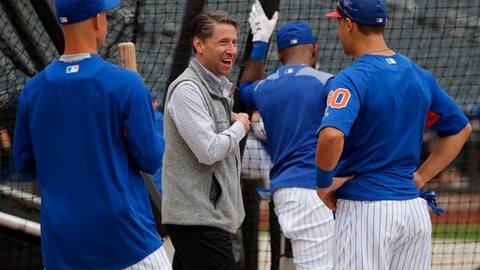 FILE - In this June 27, 2018, file photo, New York Mets chief operating officer Jeff Wilpon, center, talks with Michael Conforto and No. 1 draft pick Jerred Kelenic, left, before the team's baseball game against the Pittsburgh Pirates in New York. Wilpon wont need Jacob deGrom or Noah Syndergaard to bring a championship to New York this year. Though Wilpon is hardly a hardcore gamer, he and his family are showing a magic touch in the world of esports. The Wilpon-owned New York Excelsior have been a juggernaut during the inaugural season of the Overwatch League, and the Wilpons are being praised for their leadership of the video game club. (AP Photo/Julie Jacobson, File)