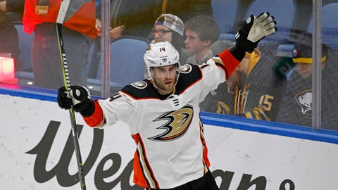 Anaheim Ducks forward Adam Henrique (14) celebrates his game winning goal during the overtime period of an NHL hockey game against the Buffalo Sabres, Tuesday, Feb. 6, 2018, in Buffalo, N.Y. (AP Photo/Jeffrey T. Barnes)