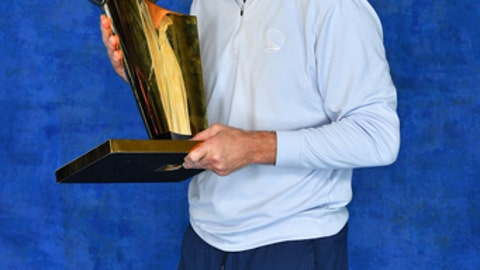 CLEVELAND, OH - JUNE 8: Steve Kerr of the Golden State Warriors poses for a portrait with the Larry O'Brien Trophy after winning Game Four of the 2018 NBA Finals against the Cleveland Cavaliers on June 8, 2018 at Quicken Loans Arena in Cleveland, Ohio. (Photo by Jesse D. Garrabrant/NBAE via Getty Images)