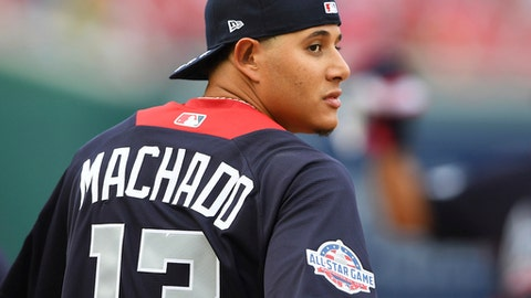 American League, Baltimore Orioles shortstop Manny Machado looks over his shoulder as he walks onto the field before the Major League Baseball All-star Game, Tuesday, July 17, 2018 in Washington. (AP Photo/Nick Wass)
