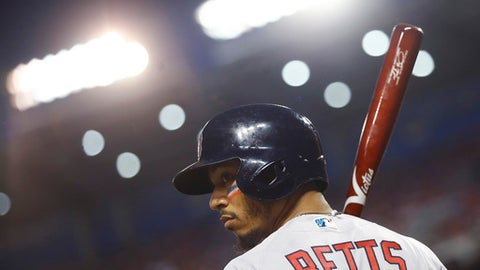 Boston Red Sox outfielder Mookie Betts (50) looks across the field during the first inning of the Major League Baseball All-star Game, Tuesday, July 17, 2018 in Washington. (AP Photo/Patrick Semansky)