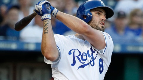 FILE - In this Wednesday, May 30, 2018, file photo, Kansas City Royals' Mike Moustakas watches his two-run home run against the Minnesota Twins during the second inning of a baseball game in Kansas City, Mo. After smacking a career-best 38 homers for the Kansas City Royals last year, the two-time All-Star third baseman didn't get a lucrative deal in free agency and returned on a one-year deal for $6.5 million plus a mutual option for 2019. He has 19 homers and 58 RBIs but is only batting .249 for the worst team in the majors that should be a big seller this month. (AP Photo/Charlie Riedel, File)