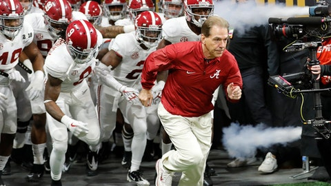 FILE - In this Jan. 8, 2018, file photo, Alabama coach Nick Saban leads his team onto the field before the NCAA college football playoff championship game against Georgia in Atlanta.  Saban should feel right at home at the College Football Hall of Fame, the facility hosting part of this week's SEC media days. The Hall of Fame in downtown Atlanta is only a short walk from Mercedes-Benz Stadium, where six months ago Sabans Alabama team beat Georgia for his sixth national championship. (AP Photo/David Goldman, File)