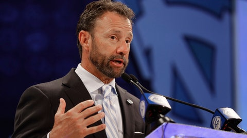 North Carolina head coach Larry Fedora answers a question during a news conference at the NCAA Atlantic Coast Conference college football media day in Charlotte, N.C., Wednesday, July 18, 2018. (AP Photo/Chuck Burton)