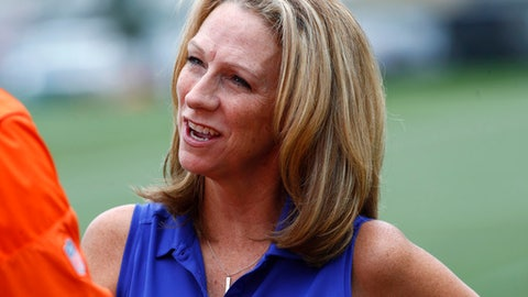 "FILE - In this Saturday, July 29, 2017, file photo, broadcaster Beth Mowins chats with a reporter at the Denver Broncos NFL football training camp in Englewood, Colo. ESPN is going with a fresh approach for its first 2018 regular-season broadcast of ""Monday Night Football."" Two announcers with plenty of NFL credentials but far more entrenched in the college game these days will be handling the Jets-Lions game from Detroit: Beth Mowins and Brian Griese. (AP Photo/David Zalubowski, File)"
