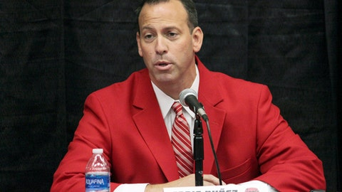 FILE - This Sept. 8, 2017 file photo shows University of New Mexico athletic director Eddie Nunez at a news conference in Albuquerque, N.M. Top officials at New Mexico's flagship university are recommending that the men's soccer team and the skiing and beach volleyball programs be eliminated to help the troubled athletics department get its finances under control. University president Garnett Stokes and Nunez announced the recommendations late Wednesday, July 18, 2018, and will present them to the Board of Regents at a special meeting Thursday. (AP Photo/Susan Montoya Bryan, File)