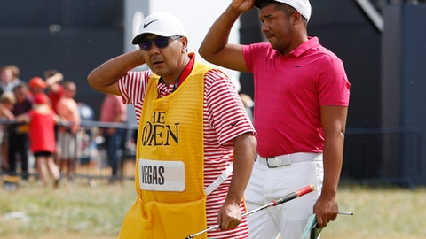 Jhonattan Vegas of Venezuela and his caddie Ruben Yorio on the 18th green during the first round of the British Open Golf Championship in Carnoustie, Scotland, Thursday July 19, 2018. (AP Photo/Alastair Grant)
