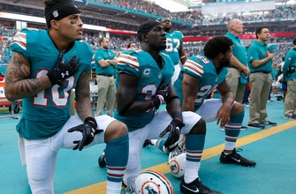 The Latest: Dolphins say
