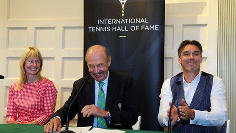 Tennis Hall of Fame inductees Helena Sukova, of Czech Republic, and Michael Stich, of Germany, react as they are introduced by Stan Smith, middle, at a news conference at the International Tennis Hall of Fame, Saturday, July 21, 2018, in Newport, R.I. (AP Photo/Elise Amendola)