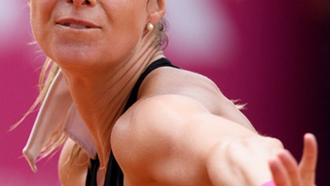 Mandy Minella of Luxembourg, returns a ball to Alize Cornet of France, during the final game at the WTA Ladies Championship tennis tournament in Gstaad, Switzerland, Sunday, July 22, 2018. (Anthony Anex/Keystone via AP)
