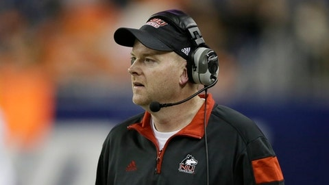 This Dec. 5, 2014 photo shows Northern Illinois head coach Rod Carey watching from the sidelines during the first half of the Mid-American Conference championship NCAA college football game against Bowling Green in Detroit. Ohio and Northern Illinois were tabbed by voters as divisional favorites in the Mid-American Conference preseason poll. The MAC held its football media day Tuesday, July 24, 2018 at Ford Field in Detroit, which is also the site of the Nov. 30 conference championship game. (AP Photo/Carlos Osorio)
