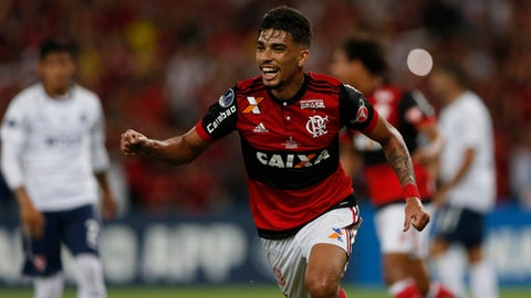 FILE - In this Dec.13, 2017 file photo, Brazil's Flamengo Lucas Paqueta celebrates after scoring during the Copa Sudamericana final championship soccer match at Maracana stadium in Rio de Janeiro, Brazil. The 20-year-old Flamengo midfielder has been so praised that Brazil coach Tite picked him for his list of possible substitutes of World Cup squad members. Paqueta is seen as a sure player to be tested in the yellow shirt until the 2022 World Cup in Qatar. (AP Photo/Silvia Izquierdo, File)