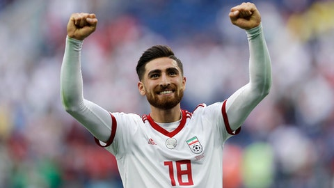 FILE - In this Friday, June 15, 2018 file photo, Iran's Alireza Jahanbakhsh celebrates his team's victory after the group B match between Morocco and Iran at the 2018 soccer World Cup in the St. Petersburg Stadium in St. Petersburg, Russia. Iran winger Alireza Jahanbakhsh has joined Brighton for a club record fee, the English Premier League club said on Wednesday, July 25, 2018. The 24-year-old Jahanbakhsh signed a five-year contract after leaving Dutch club AZ Alkmaar. (AP Photo/Themba Hadebe, file)