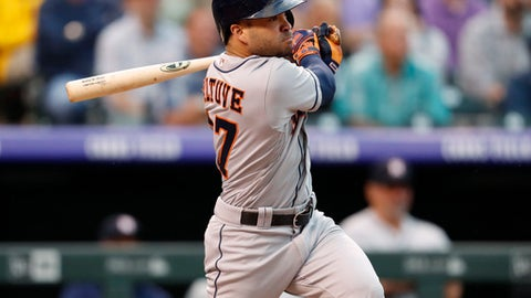 Houston Astros' Jose Altuve watches his RBI-double off Colorado Rockies starting pitcher Jon Gray during the fourth inning of a baseball game Wednesday, July 25, 2018, in Denver. (AP Photo/David Zalubowski)