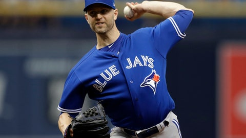 FILE - In this June 13, 2018, file photo, Toronto Blue Jays' J.A. Happ pitches to the Tampa Bay Rays during the first inning of a baseball game in St. Petersburg, Fla. . A person with knowledge of the talks tells The Associated Press the New York Yankees are nearing a deal to acquire Happ from Toronto to bolster their starting rotation.  The Yankees would send infielder Brandon Drury and minor league outfielder Bill McKinney to the Blue Jays, the person said Thursday, July 26, 2018, speaking on condition of anonymity because the trade was subject to the teams approving medical records.  (AP Photo/Chris O'Meara, File)
