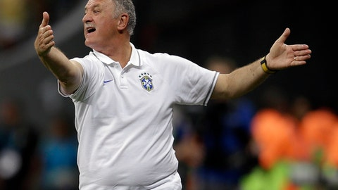 FILE- In this July 12, 2014 file photo, Brazil's coach Luiz Felipe Scolari yells instructions to his players during the World Cup third-place soccer match between Brazil and the Netherlands at the Estadio Nacional in Brasilia, Brazil. Scolari signed a contract with Palmeiras on Thursday, July 26, 2018, returning home for the first time since his humiliation at the 2014 World Cup. (AP Photo/Natacha Pisarenko, File)