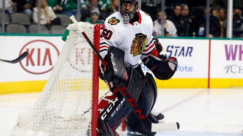 Chicago Blackhawks goalie Corey Crawford (50) defends the goal against the Dallas Stars during the first period of an NHL hockey game in Dallas, Thursday, Dec. 21, 2017. (AP Photo/ Michael Ainsworth)