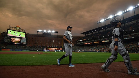 Tampa Bay Rays pitcher Chris Archer, left, walks into the dugout before starting against the Baltimore Orioles in a baseball game, Friday, July 27, 2018, in Baltimore. (AP Photo/Gail Burton)