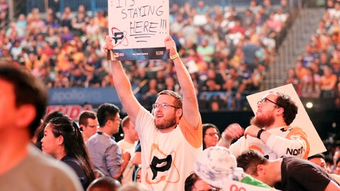 In this Friday, July 27, 2018, file photo, Philadelphia Fusion fan holds up a sign during the Overwatch League Grand Finals' first night of competition at the Barclays Center in the Brooklyn borough of New York. The Overwatch League is making a grand gamble: that its deep pockets and massive infrastructure can keep it atop the esports mountain even as Fortnite comes charging for the crown.  (AP Photo/Terrin Waack)