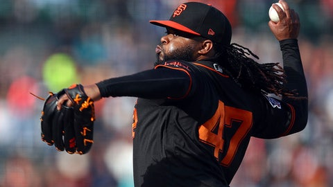 San Francisco Giants pitcher Johnny Cueto works against the Milwaukee Brewers in the first inning of a baseball game Saturday, July 28, 2018, in San Francisco. (AP Photo/Ben Margot)