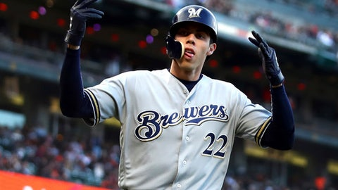 Milwaukee Brewers' Christian Yelich celebrates after hitting a home run off San Francisco Giants' Ty Blach in the fifth inning of a baseball game Saturday, July 28, 2018, in San Francisco. (AP Photo/Ben Margot)