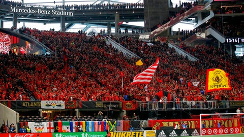 FILE - In this March 11, 2018, file photo, fans wait for an MLS soccer match between D.C. United and Atlanta United in Atlanta. The MLS All-Star Game will feature one of the world's most storied clubs. Unfortunately for the more than 70,000 fans expected at Mercedes-Benz Stadium, Cristiano Ronaldo is not along for the ride. After Portugal's elimination from the World Cup and his transfer from Real Madrid, the five-time FIFA Player of the Year took time off rather than accompany Juventus on its American preseason tour, which includes Wednesday night's game against top players from Major League Soccer. (AP Photo/Todd Kirkland, File)