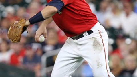 Minnesota Twins' Brian Dozier looks to throw the ball against the Cleveland Indians in the sixth inning of a baseball game Monday, July 30, 2018 in Minneapolis. Minnesota won 5-4. (AP Photo/Stacy Bengs)