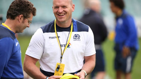 FILE - In this Friday, June 16, 2017 file photo, Scotland's rugby union head coach Gregor Townsend, right, laughs with a team member during their captain's run in Sydney. Scotland coach Gregor Townsend has been rewarded for winning nine of his 14 games in charge with a new contract that will keep him in place until 2021. (AP Photo/Rick Rycroft, File)