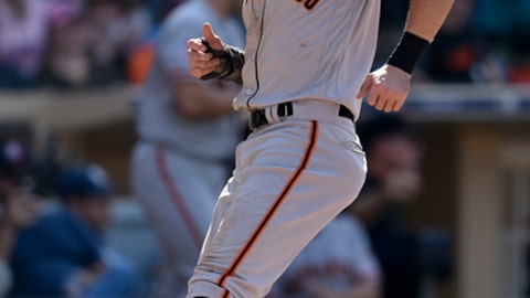 San Francisco Giants' Evan Longoria scores a run off an RBI single by Brandon Crawford during the tenth inning of a baseball game against the San Diego Padres in San Diego, Tuesday, July 31, 2018. (AP Photo/Kelvin Kuo)