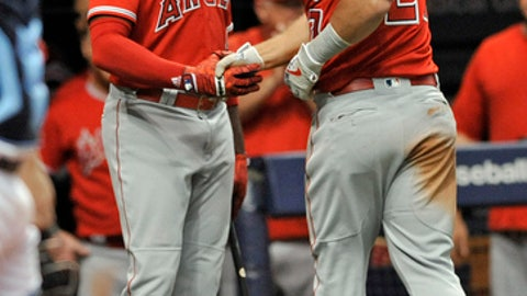 Los Angeles Angels on-deck batter Justin Upton, left, congratulates Mike Trout, right, after his solo home run off Tampa Bay Rays reliever Ryan Yarbrough during the seventh inning of a baseball game Tuesday, July 31, 2018, in St. Petersburg, Fla. (AP Photo/Steve Nesius)