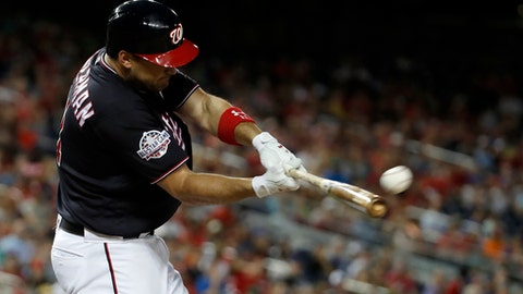 Washington Nationals' Ryan Zimmerman hits a home run during the fourth inning of the team's baseball game against the New York Mets at Nationals Park, Tuesday, July 31, 2018, in Washington. The Nationals won 25-4. (AP Photo/Alex Brandon)