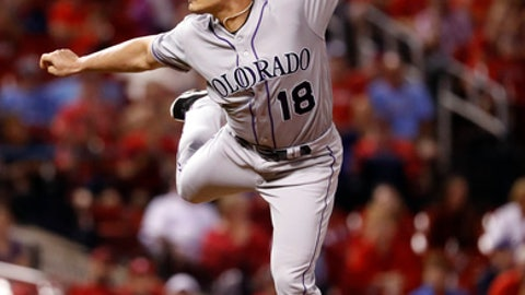 Colorado Rockies relief pitcher Seunghwan Oh throws during the eighth inning of a baseball game against the St. Louis Cardinals Tuesday, July 31, 2018, in St. Louis. (AP Photo/Jeff Roberson)