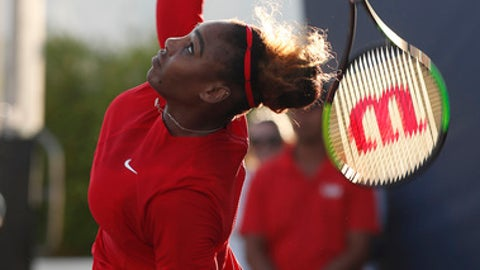 Serena Williams, of the United States, serves against Johanna Konta, from Britain, during the first set of the Mubadala Silicon Valley Classic tennis tournament in San Jose, Calif., Tuesday, July. 31, 2018. (AP Photo/Tony Avelar)